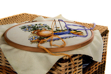 basket embroidery: Manual embroidery in a wattled basket on the isolated background