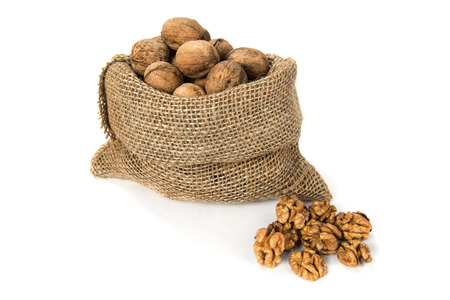 hard component: Walnuts in a bag on the white isolated background Stock Photo
