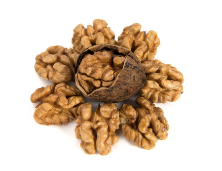 hard alloy: The walnuts cleared on the white isolated background