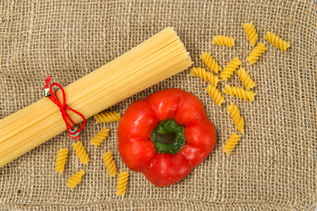 Pasta on canvas with red pepper photo