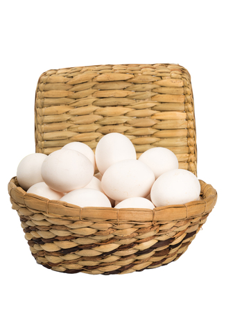wattled: Eggs in a wattled basket on the isolated background