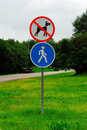 walking zone: Walking of dogs prohibited and pedestrian zone Stock Photo