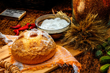 conkers: Freshly baked bread in rustic setting Stock Photo