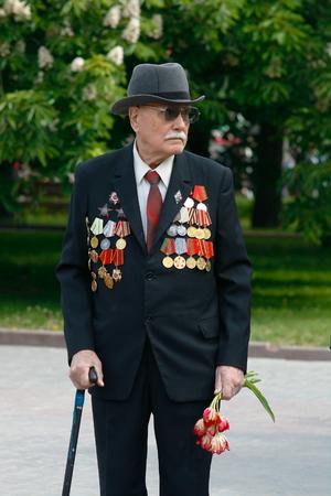 volgograd: VOLGOGRAD, RUSSIA - MAY 9, 2008: World War II veteran on Victory Day celebration  on the Ploshhad Pavshih Borcov (the Square of the Fallen Fighters) in Volgograd