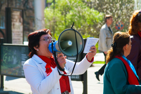 demonstrator: VOLGOGRAD, RUSSIA - MAY 1, 2011: Demonstrator with a megaphone in the May day demonstration in Volgograd