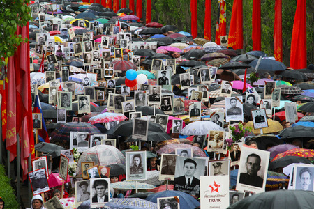 relatives: VOLGOGRAD, RUSSIA - MAY 9, 2015: Procession of local people with photos of their relatives in Immortal Regiment on annual Victory Day on Mamaev Hill in Volgograd