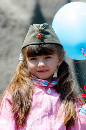 garrison: VOLGOGRAD, RUSSIA - MAY 9, 2008: A little girl in a military garrison cap on Victory Day celebration on Mamaev hill in Volgograd