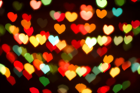 blurring: Blurring lights bokeh background of colorful hearts Stock Photo