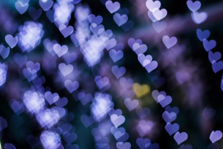 corazones azules: Blurring lights bokeh background of blue hearts Foto de archivo