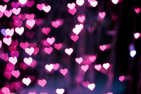 blurring: Blurring lights bokeh background of pink hearts Stock Photo