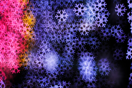 blurring: Blurring lights bokeh background of snowflakes