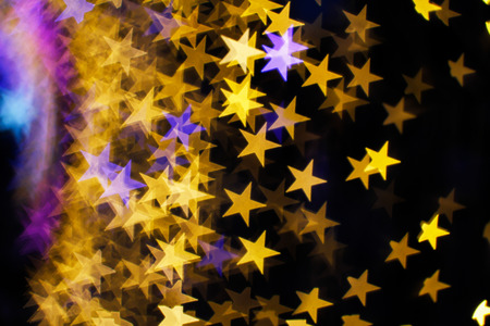 newyear night: Blurring lights bokeh background of stars
