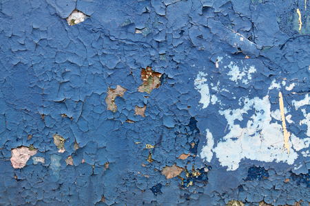 plies: Old blue paint with cracks on the wall