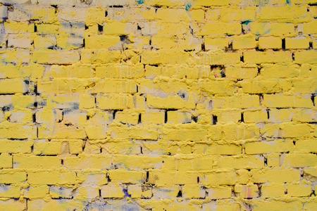 untidiness: Yellow brick wall