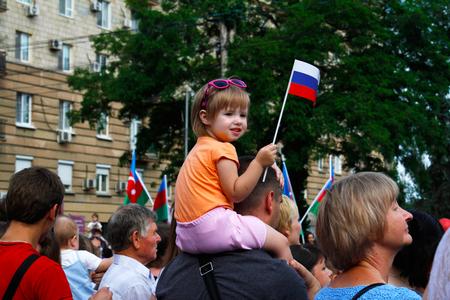 volgograd: VOLGOGRAD, RUSSIA - JUNE 12, 2015:Girl with flag in celebration of independence Day of Russia in Volgograd