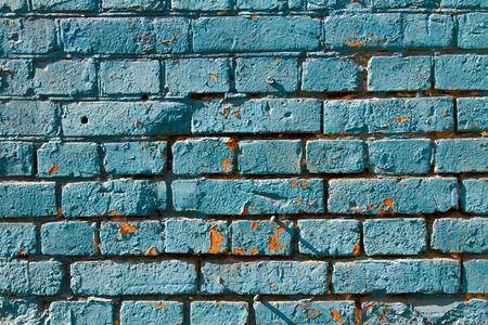 untidiness: Blue painted brick wall