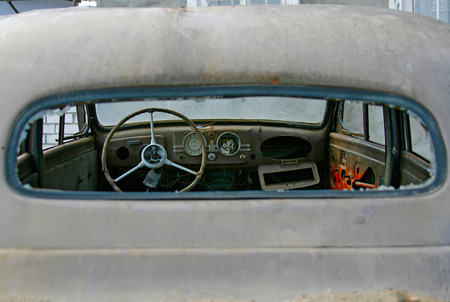 abandoned car: The instrument panel and steering wheel of the old abandoned car Stock Photo