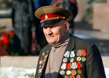 Volgograd, Russia - February 2, 2008: World War II veteran on Victory Day in the battle of Stalingrad on the Ploshhad Pavshih Borcov (the Square of the Fallen Fighters) in Volgograd