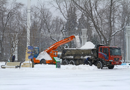 autotruck: Moscow, Russia - January 13, 2016: Workers clean from the road snow in VDNKh in Moscow