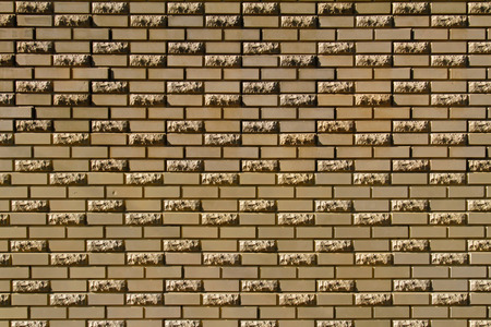 facing a wall: Brick wall made of light yellow facing bricks