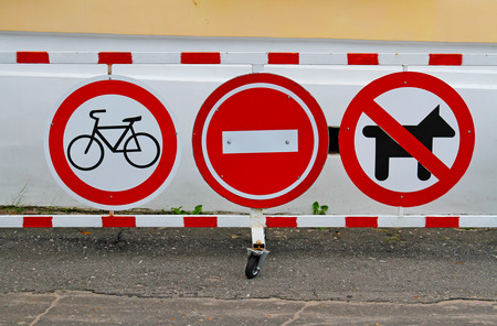 Street signs No Cycling, No entry, No dogs on the barrier