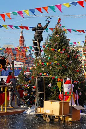 Moscow, Russia - November 30, 2016: Workers decorate Christmas tree on the Red Square in Moscow