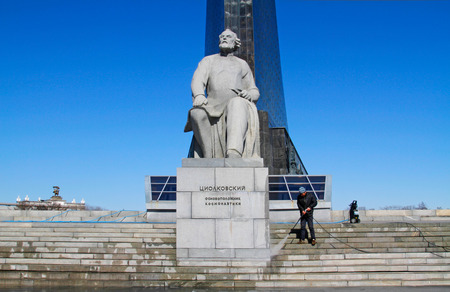 Moscow, Russia - April 05, 2016: Worker clean with a pressure washer the monument to the founder of cosmonautics Konstantin Tsiolkovsky in Moscow.