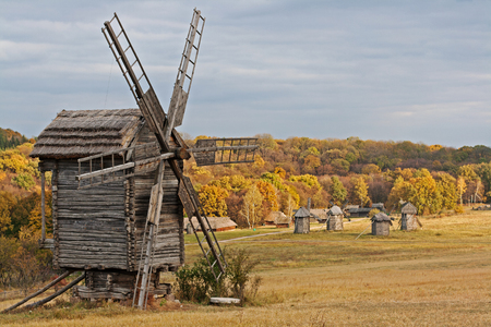 Old wooden windmill in the countryside in autumn season Stock Photo