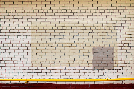 spot the difference: Colorful (yellow, beige, grey) painted wall with yellow pipe as background, texture Stock Photo