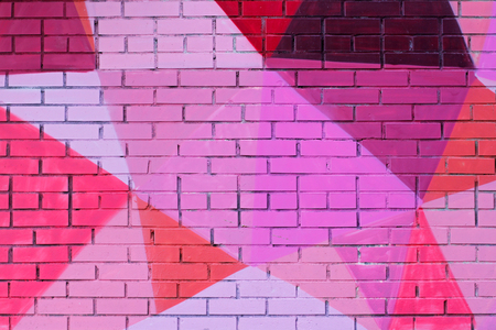 Colorful (pink, purple, coral and burgundy) painted brick wall as background, texture Stock Photo