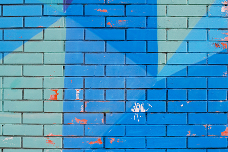 plies: Old colorful (blue) paint with cracks on brick wall as background, texture Stock Photo