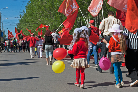 Volgograd, Russia - May 1, 2012: People take part in the May day demonstration in Volgograd Editorial