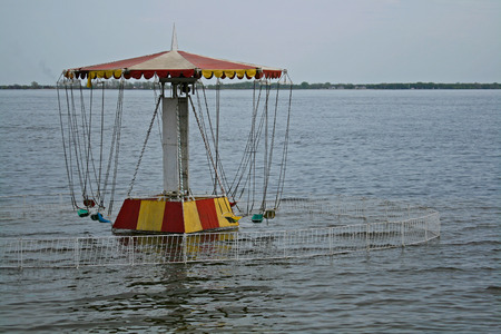 Carousel on the waterfront filled with water during the flood