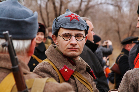 Volgograd, Russia - November 21, 2010: Portrait of actor dressed as Russian Soviet soldier of World War II in military-historical reconstruction in Volgograd. Editorial