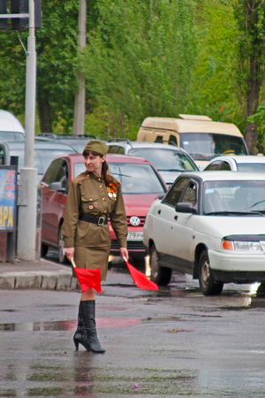 soldiers: Volgograd, Russia - May 9, 2010: Soviet traffic controller in uniform of World War II indicates the direction in Volgograd