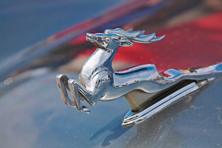 animal figurines: Volgograd, Russia - May 09, 2010: Running deer emblem on the hood of Soviet car Volga GAZ-21 Editorial