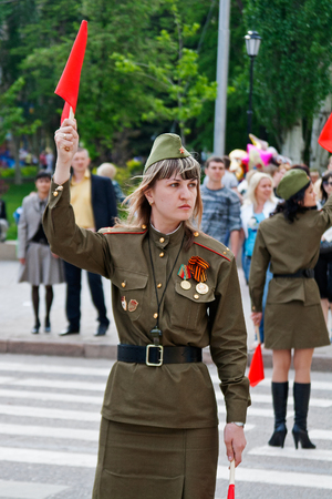 traffic controller: Volgograd, Russia - May 9, 2010: Soviet traffic controller in uniform of World War II indicates the direction on the Avenue of Heroes in Volgograd Editorial