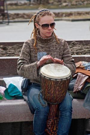 Volgograd, Russia - April 03, 2011: Portrait of woman plays the djembe drum in Volgograd