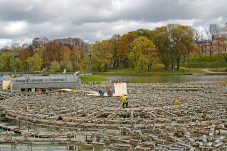 adjuster: Moscow, Russia - October 15, 2008: The workers produce the preservation of the fountain for the winter in Tsaritsyno Park in Moscow Editorial