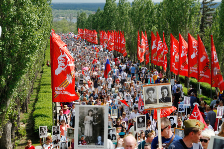 Volgograd, Russia - May 9, 2016: Procession of local people with photos of their relatives in Immortal Regiment on annual Victory Day on Mamaev Hill in Volgograd