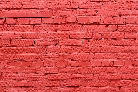 Red brick wall with patterns as background, texture