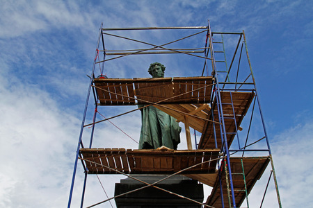 Moscow, Russia - June 30, 2015: Monument of famous russian poet Alexander Pushkin is closed for reconstruction on Pushkin square in Moscow