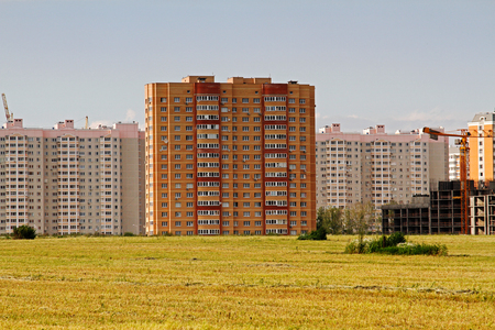 Residential buildings under construction in the field