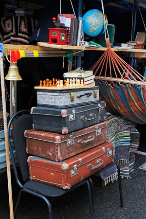Moscow, Russia - September 05, 2015: Still life of vintage suitcases, chess, books at the festival