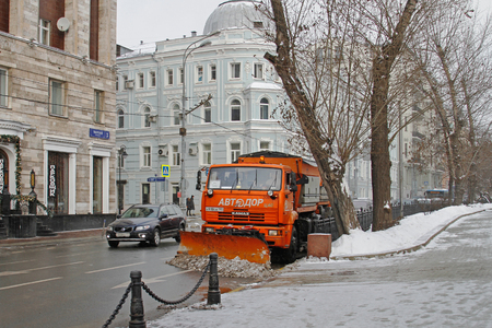 Moscow, Russia - December 11, 2016: Snowplow cleans from the road snow in Moscow