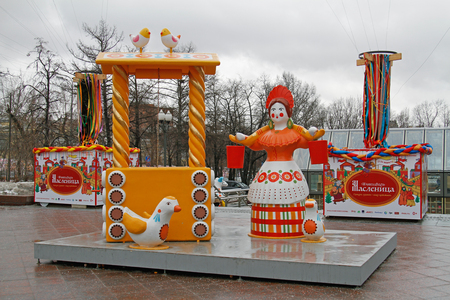 Moscow, Russia - February 27, 2017: Traditional Dymkovo toy woman with a yoke and buckets Editorial