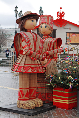 Moscow, Russia - February 27, 2017: Russian Shrovetide statues of man and woman in traditional colorful dress