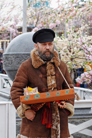 Moscow, Russia - February 25, 2017: Peddler at the Russian national festival Editorial