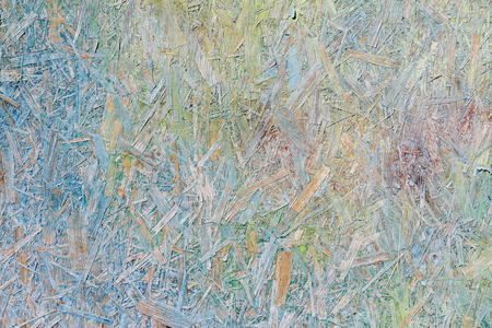 Colorful (green, blue and yellow) painted OSB board as background, texture