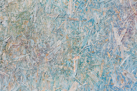 Colorful (green, blue, violet, white and yellow) painted OSB board as background, texture